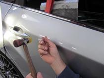 repairing a dented door