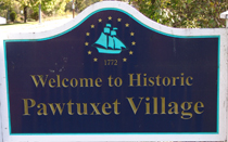 the welcome to historic Pawtuxet Village sign